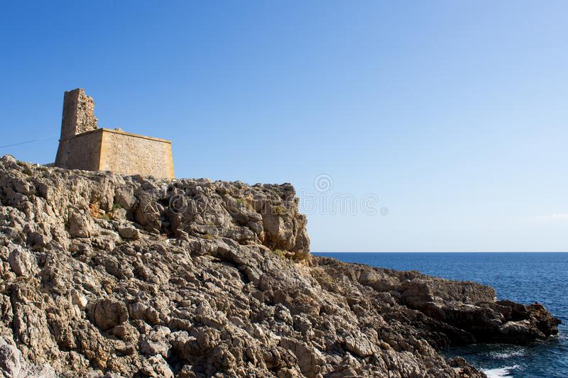 Ruins on the rocky coast with mediterranean sea in Background in Sicily royalty free stock photo
