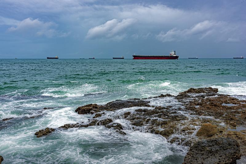 Some ships moored during bad weather at Todos os Santos Bay stock photos