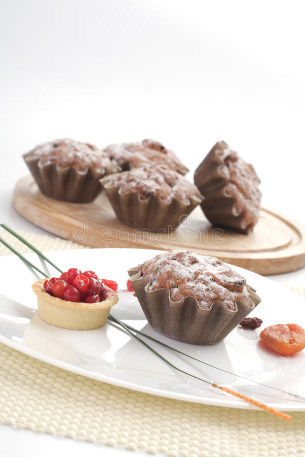 Some small round fruitcakes with raisin. stock images