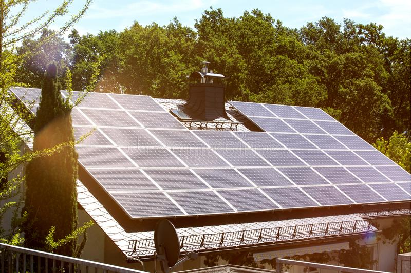 Solar cells on a house roof. Some solar cells on a house roof stock photos