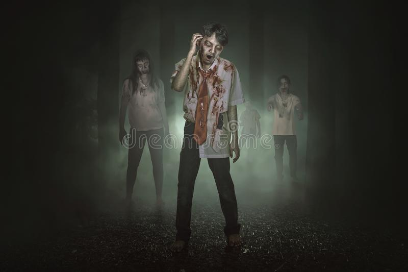 Some spooky asian zombies with blood walking around royalty free stock images
