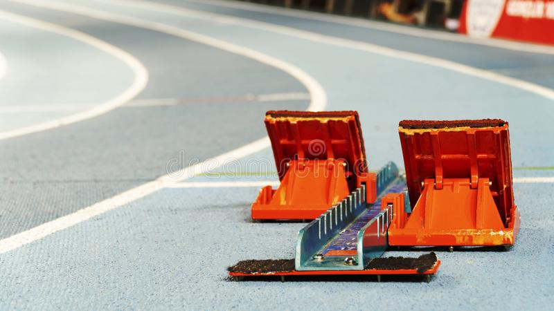 Some starting block on running track royalty free stock image