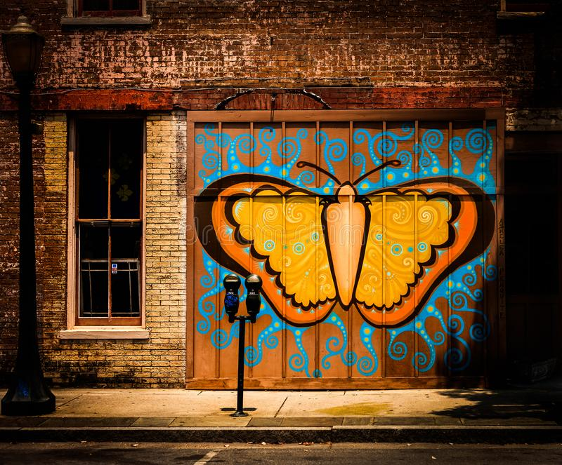 Butterfly graffiti in the city royalty free illustration