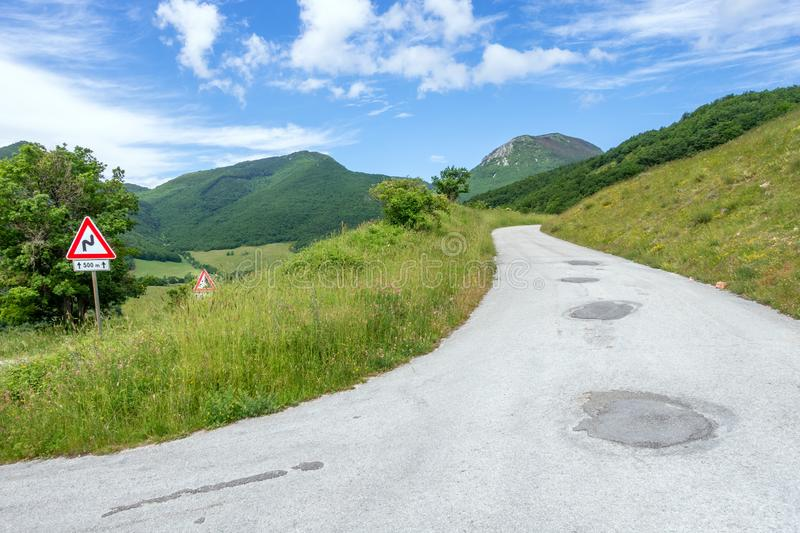 Some street signs on a steep road. An image of some street signs on a steep road stock photos