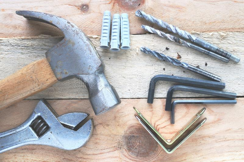 Some tools on a wooden desktop in a workshop. DIY and bricolage concept. Top view stock images