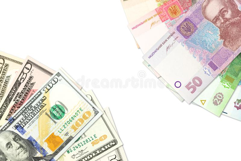 Some ukrainian hryvnia banknotes and american dollar banknotes indicating bilateral economic relations with copyspace. Ukrainian hryvnia banknotes and american stock photo
