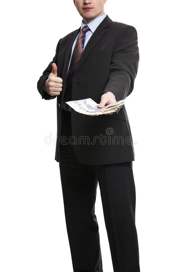 Some unrecognizable Businessman in suit showing a Spread of Pound Sterling Cash and thumb up royalty free stock photography