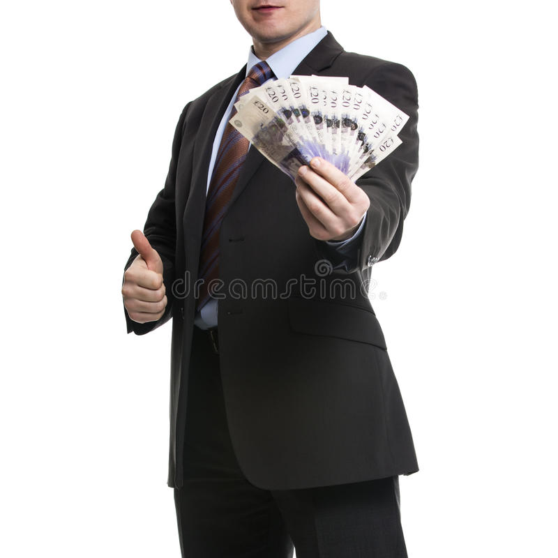 Some unrecognizable Businessman in suit showing a Spread of Pound Sterling Cash and thumb up. Some unrecognizable Businessman in suit showing a Spread of Cash royalty free stock photography