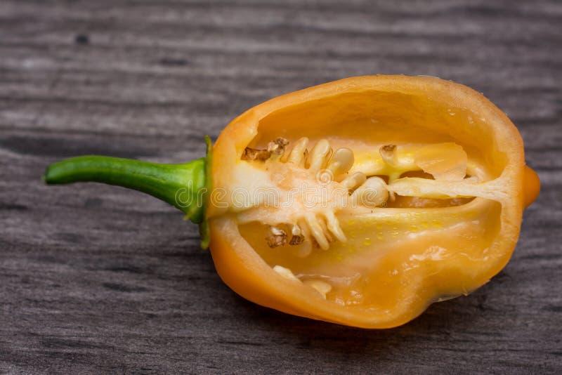 Some vegetable of orange chili pepper habanero sliced  on wooden vintage background royalty free stock images