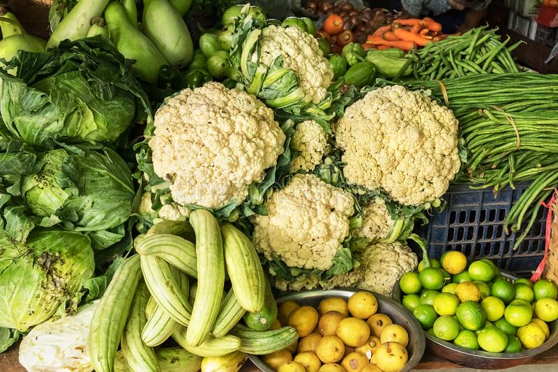 Some vegetables, like as cauliflower, cabbage, kale, carrots, zucchini, limes in a farmers market. Some vegetables  in a farmers market royalty free stock photos