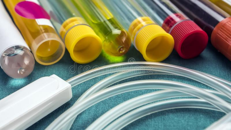 Some vials with samples of contagious diseases and drop in a clinical laboratory. Conceptual image stock photos