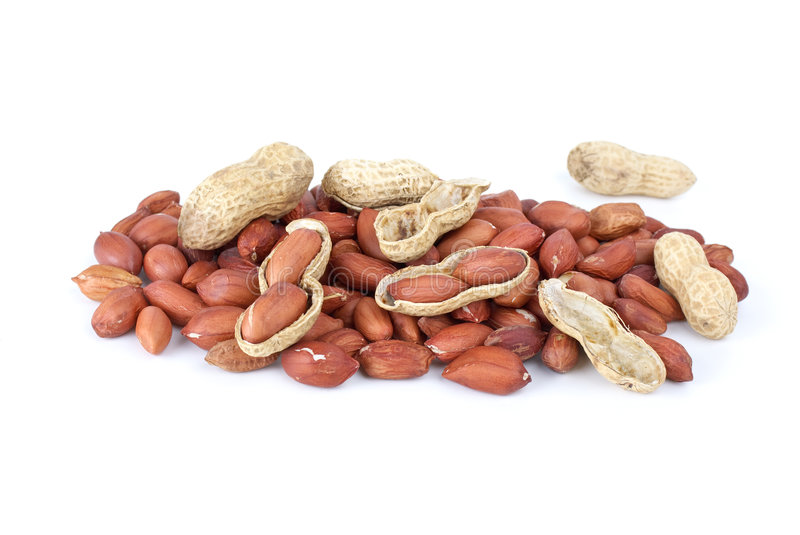 Some whole, shelled roasted peanuts and husk royalty free stock images