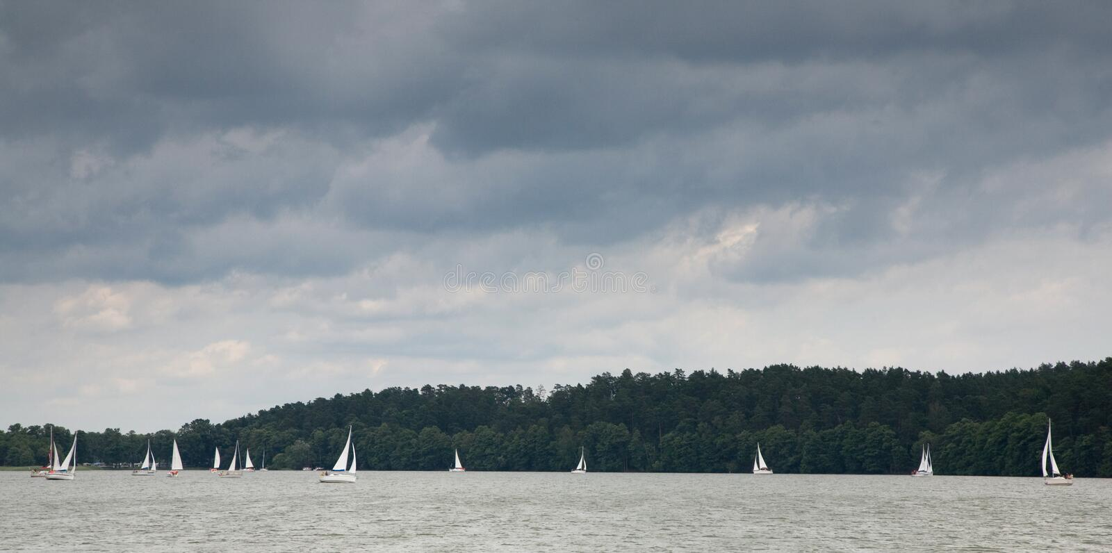 Download Some Yachts Sailing Under Stormy Sky Stock Photo - Image: 6448382
