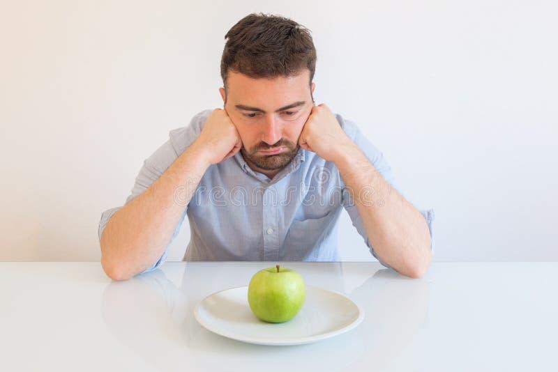 Somente uma maçã antropófaga furada para a dieta fotografia de stock royalty free