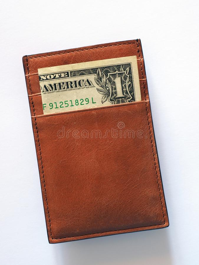 Somente uma nota de dólar na carteira do cartão imagem de stock