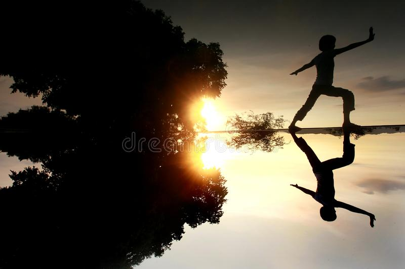 Morning exercice at beautiful lake. Someone doing morning exercise , beautiful reflection reflecting on the lake。Location: Taiwan Leisure Farm royalty free stock images