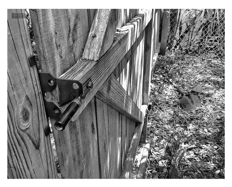 Someone forgot to close the gateâ–ª BW hate with black iron fixtures and latch. Someone forgot to close the gateâ–ª BW hate with black iron fixtures and stock photos