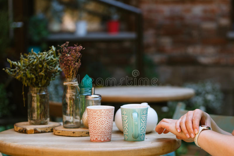 Someone is getting late. Woman checking time on his watch while royalty free stock images
