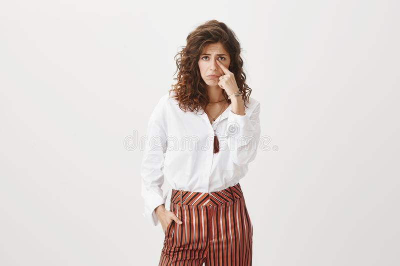 Someone made poor girl cry. Unhappy upset attractive and cute female with curly hair, frowning and sulking, crying royalty free stock photos
