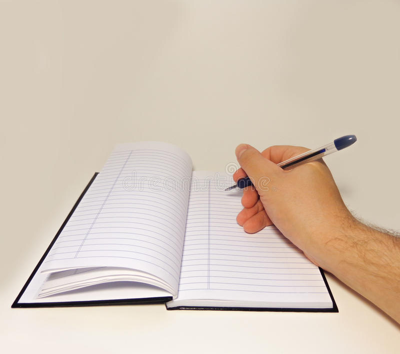 Someone writing in a notebook II royalty free stock images
