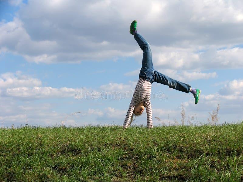 Download Somersault fotografia stock. Immagine di erba, bambino - 213384