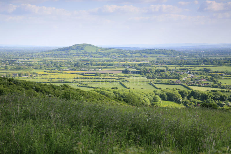 Somerset landscape. Brent Knoll viewed from the top of the Mendip hills in Somerset stock images