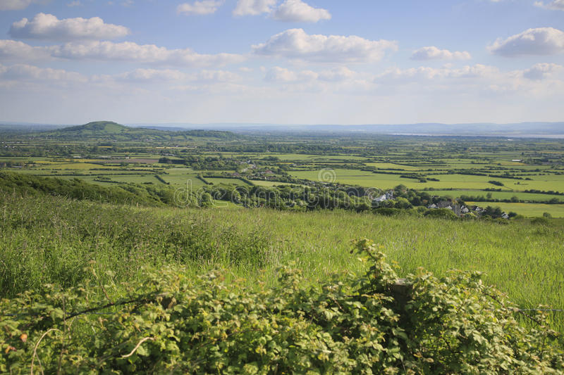 Somerset landscape view. View across to Brent Knoll, Somerset from the Mendip hills royalty free stock images