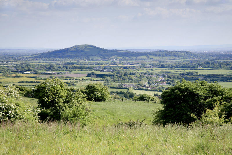 Somerset landscape view. Somerset levels viewed form the Mendip hills with Brent Knoll in the distance royalty free stock images