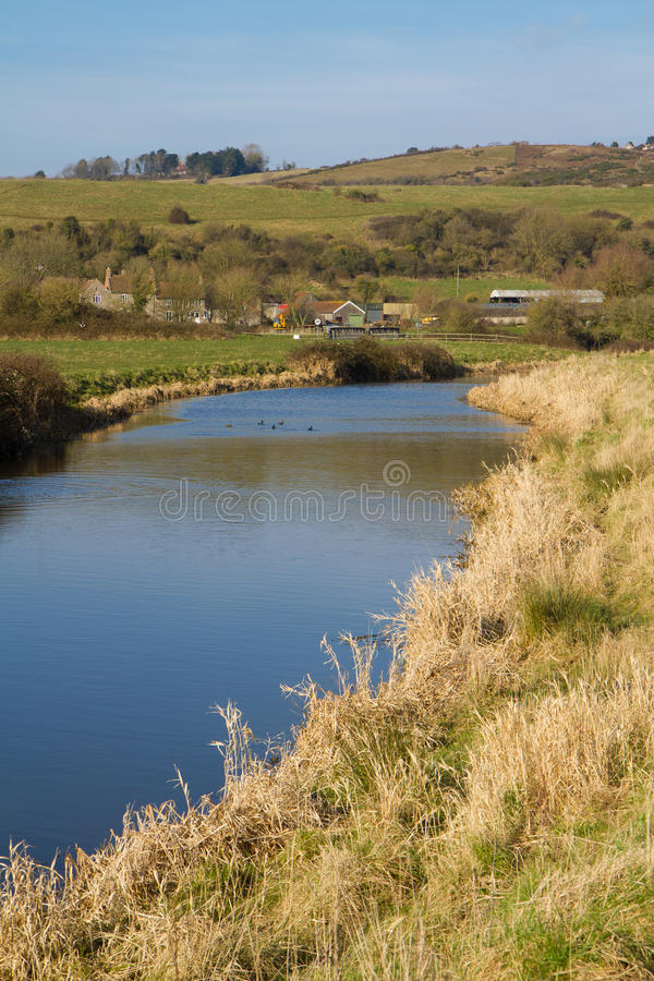 Somerset River England. The River Axe in Somerset England located near to the A370 Bleadon and Weston-super-mare royalty free stock photos