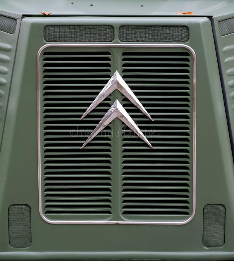 Somerset UK. October 2019. Retro Citroen logo on the front grille of a retro green Citroen van. Photographed in Somerset UK stock photo