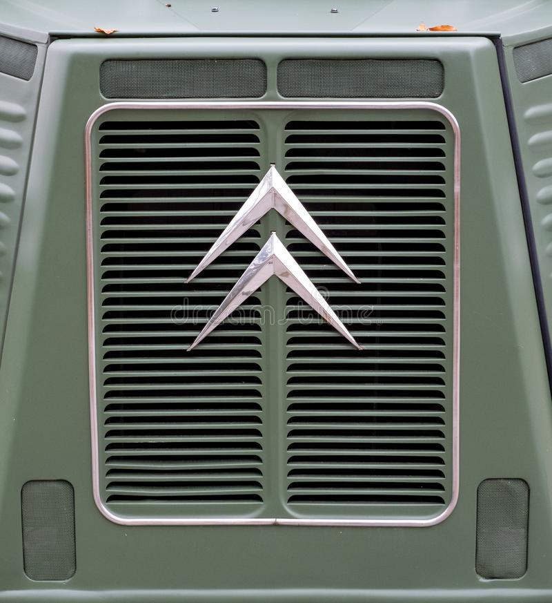 Somerset UK. October 2019. Retro Citroen logo on the front grille of a retro green Citroen van. Photographed in Somerset UK royalty free stock photography