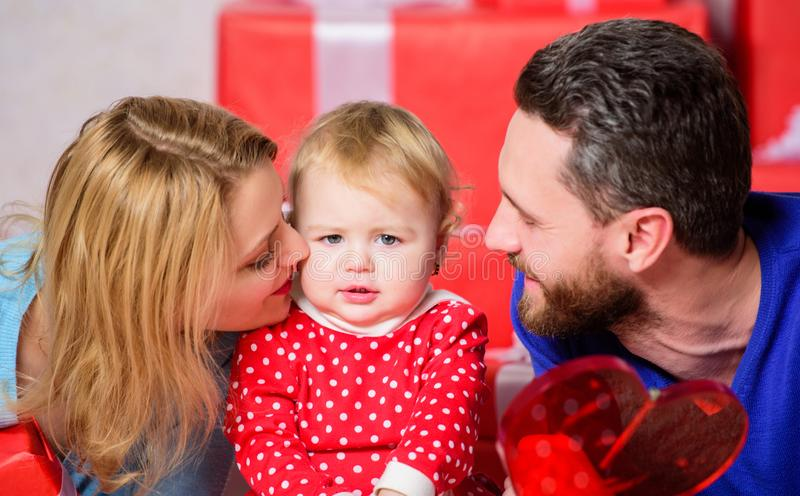Something is going to surprise her. father, mother and doughter child. Happy family with present box. Valentines day royalty free stock photo