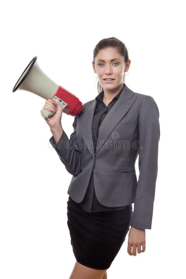 Something to shout about. Business woman holding a bullhorn royalty free stock photo