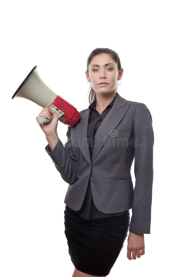 Something to shout about. Business woman holding a bullhorn stock image