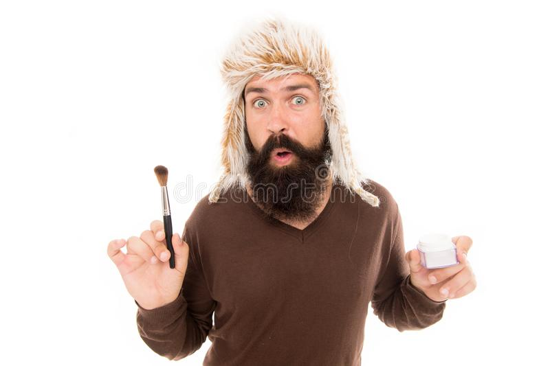 Sometimes fashion goes weird. What if add makeup. Man bearded fashion stylist wear furry hat hold brush for applying stock photography