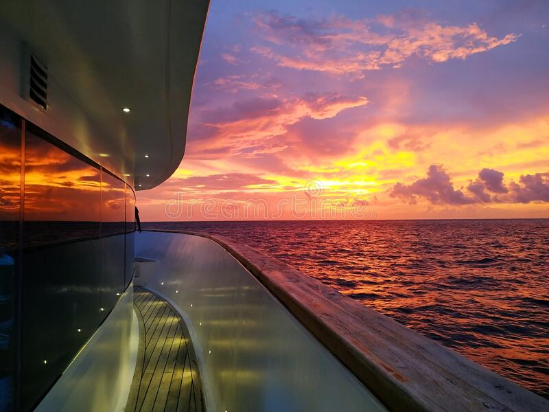 Somewhere in Maldives / while sailing sunset captured royalty free stock image