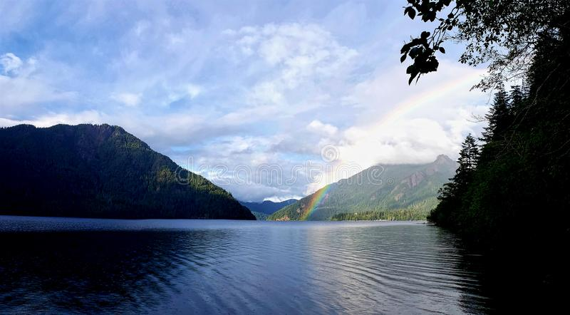Somewhere over the rainbow. Water, blue, sky, clouds, lake, nature, colorful, ripples, fishing, outdoors, calling, camping, hiking, summer royalty free stock photo