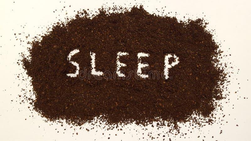 Sommeil défini en cafè moulu image stock