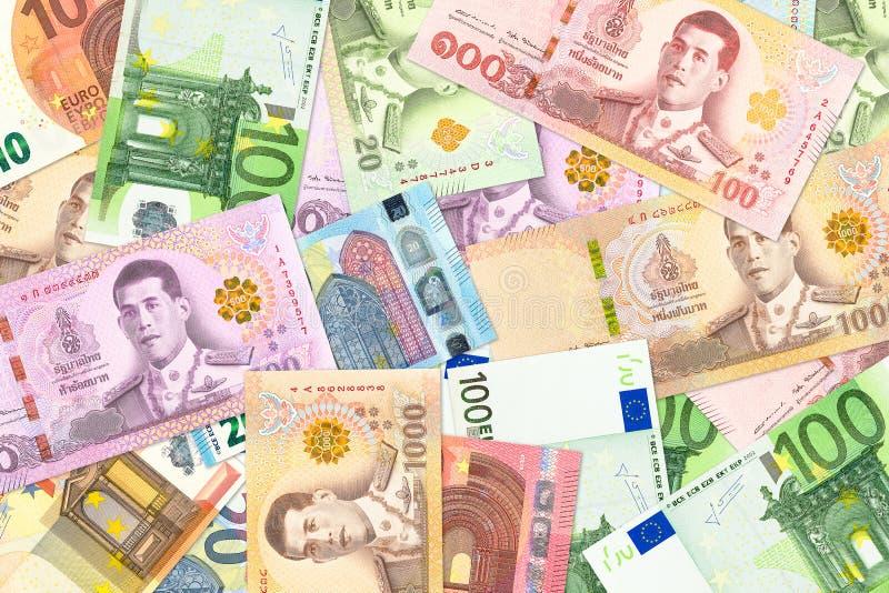 Sommige Thais Baht en euro bankbiljetten die op handelsbetrekkingen wijzen