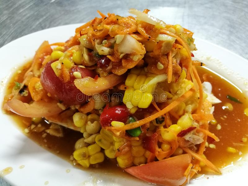 Somtum a Spicy sweet corn and salted egg Thai salad stock image