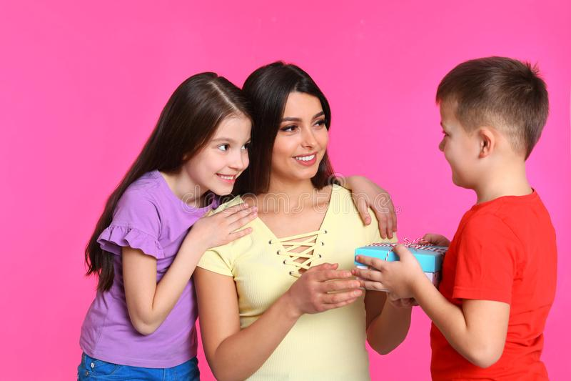 Son and daughter congratulating mom on background. Happy Mother`s Day royalty free stock images