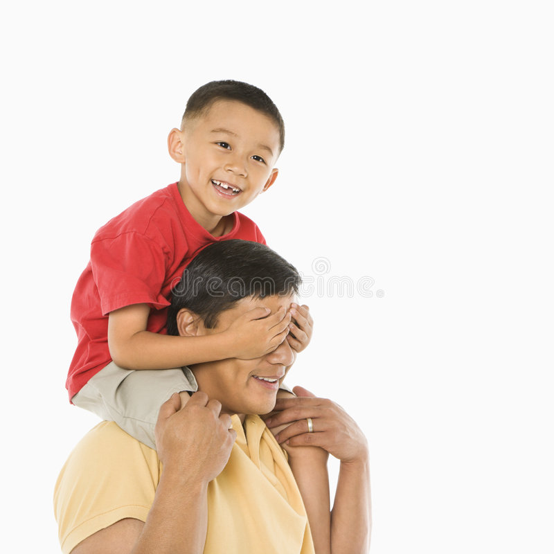 Son on father's shoulders. stock photography