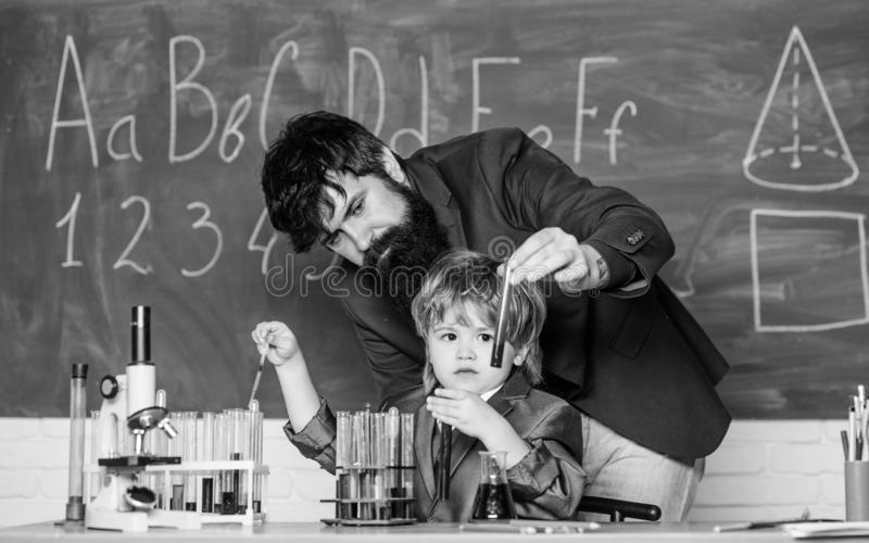 Son and father at school. small boy with teacher man. Future dna technology. Back to school. Biotech science Concept royalty free stock photography