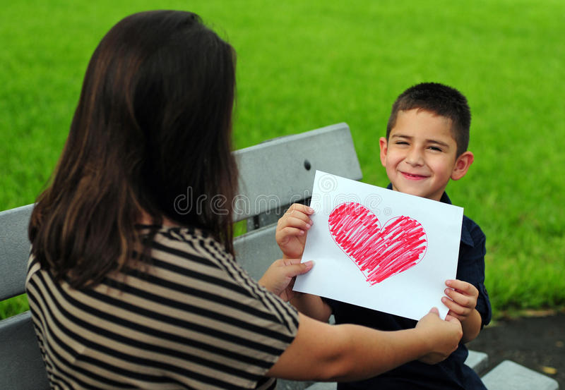 Download Son Giving Mom Heart Drawing Stock Photo - Image: 25314512