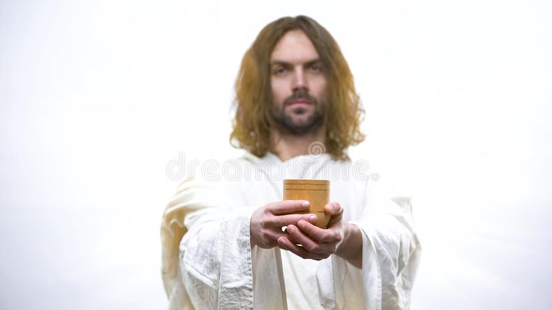 Son of God holding wine, sacramental Eucharist in Catholic church, Communion. Stock photo royalty free stock images