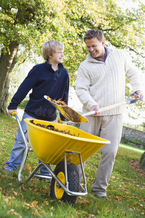 Download Son Helping Father Collect Leaves Stock Image - Image: 5308445