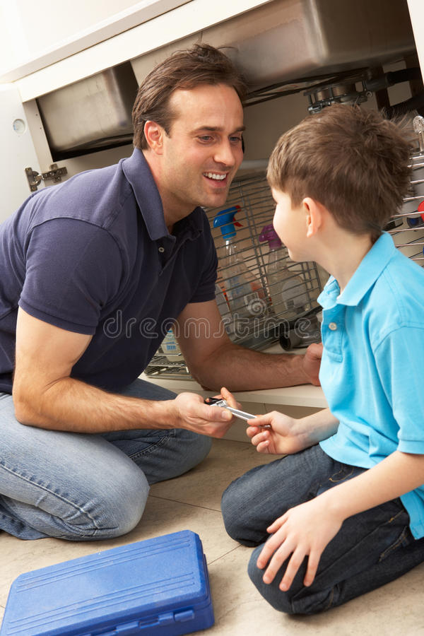 Download Son Helping Father To Mend Sink Stock Image - Image: 18745023