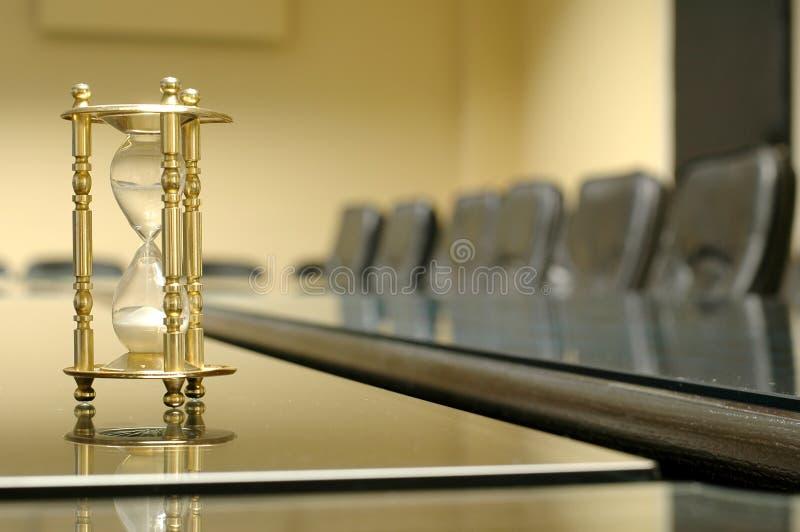 Son heure pour la réunion d'affaires photo libre de droits
