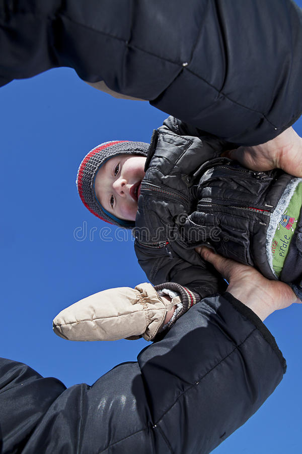 Son in his fathers shoulders royalty free stock image