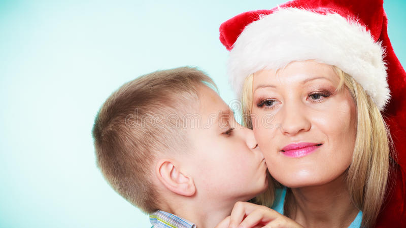 Son is kissing his mother stock photos